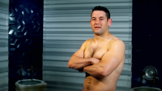 handsome man looking at camera in turkish bath - taking a bath stock videos & royalty-free footage