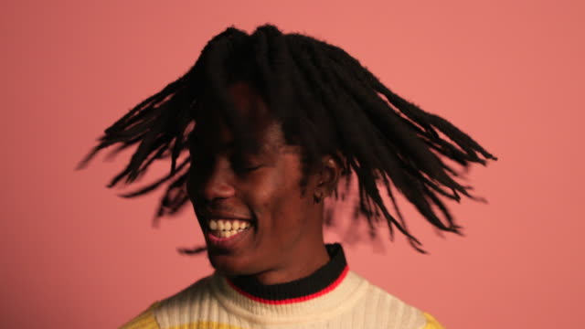 handsome man shaking dreadlocks - colored background stock videos & royalty-free footage