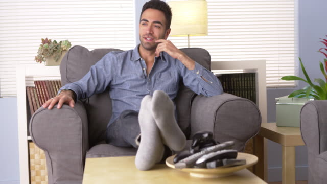handsome man sitting at home thinking - all shirts stock videos & royalty-free footage