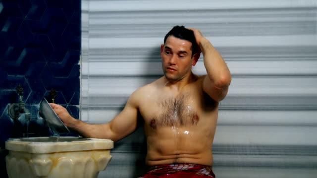 handsome man taking shower in turkish bath - bathhouse stock videos & royalty-free footage