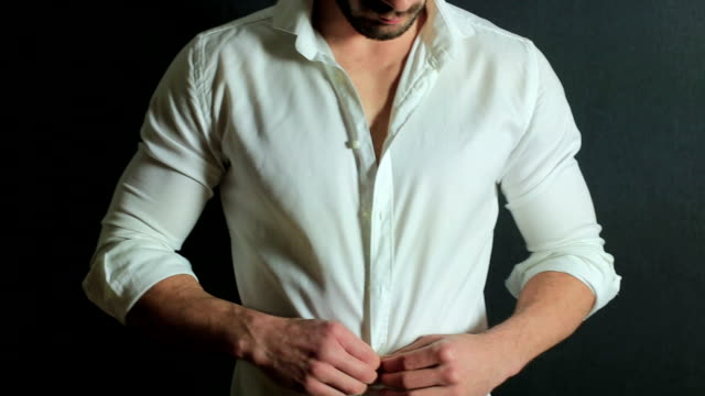 handsome man unbuttoning his shirt - beard stock videos & royalty-free footage