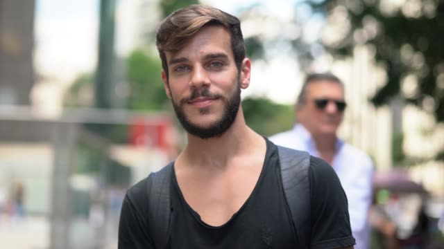 handsome man with black shirt and beard portrait in the city - black shirt stock videos & royalty-free footage