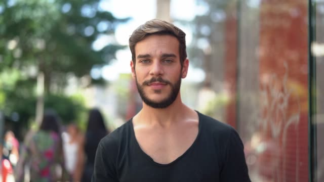 handsome man with black shirt and beard portrait in the city - latin american and hispanic stock videos & royalty-free footage