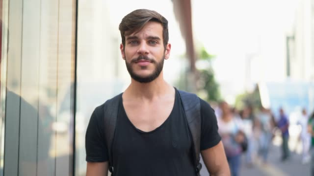 handsome man with black shirt and beard portrait in the city - one young man only stock videos & royalty-free footage