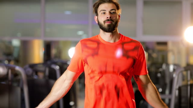handsome muscular man with jumping rope - sportswear stock videos & royalty-free footage