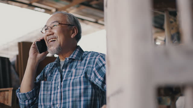 handsome senior man talking on smart phone - hot desking stock videos & royalty-free footage