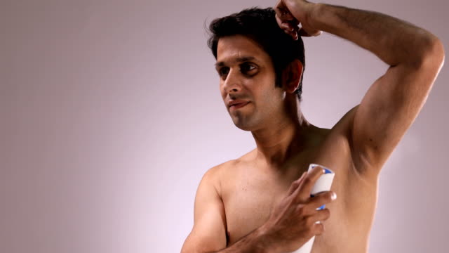 cu handsome shirtless man spraying deodorant on his armpit / new delhi, delhi, india - armpit stock videos and b-roll footage