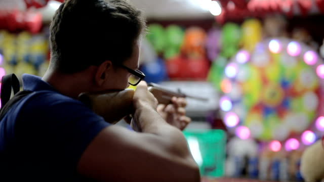 handsome young man aiming at a target - target shooting stock videos & royalty-free footage
