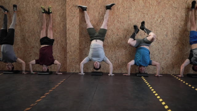 handstand gym exercises - upside down stock videos & royalty-free footage
