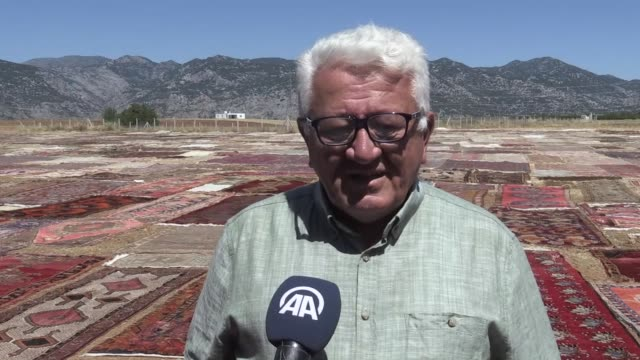 handwoven carpets lying in fields for sterilization and gaining their pastel colors in the sun create colorful images in turkey's mediterranean... - mediterranean turkey stock videos and b-roll footage