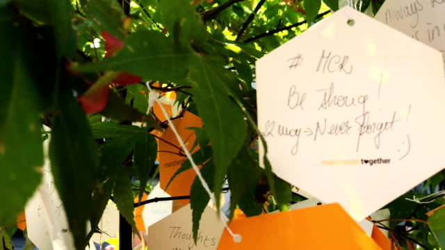 A handwritten message is seen on one of the 'Trees of Hope' placed throughout the city on the morning of the first anniversary of the terrorist...