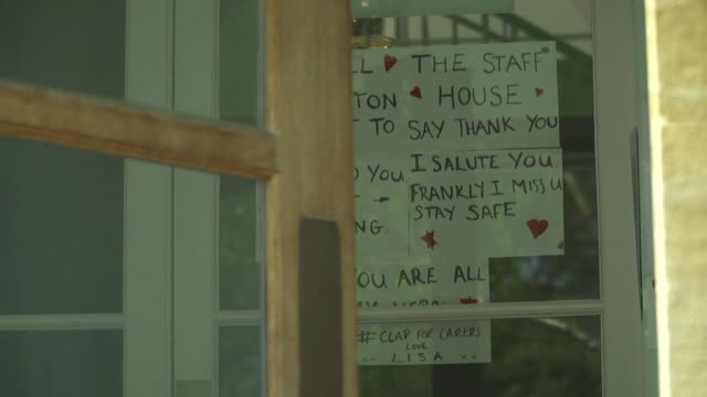 handwritten note on care home door thanking carers for looking after the residents during lockdown due to the coronavirus pandemic bath - building entrance stock videos & royalty-free footage