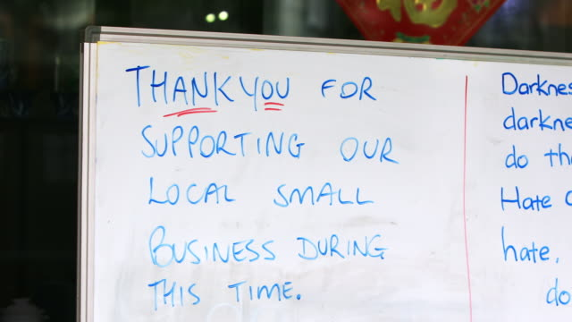 handwritten thank you sign on retail store during covid-19 - shop sign stock videos & royalty-free footage