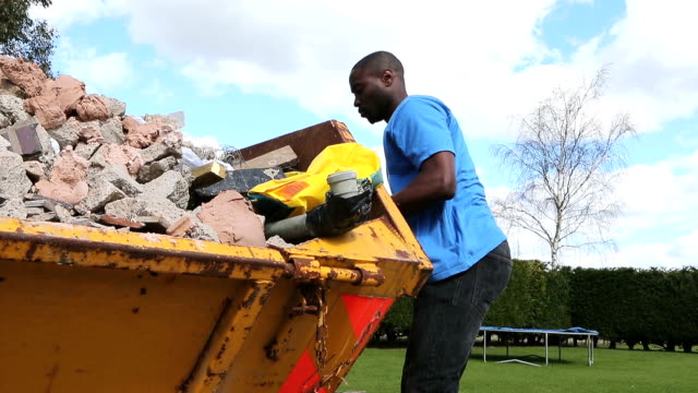 Handyman Empty Rubble into Skip
