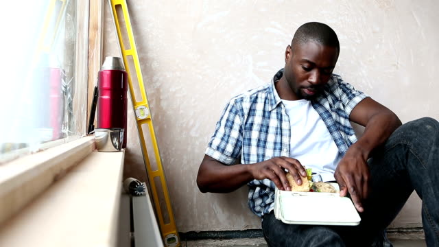 Handyman Having Packed Lunch