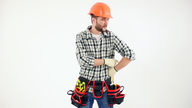 Handyman in protective helmet dancing
