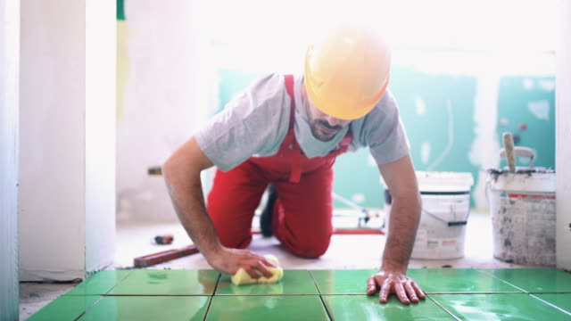handyman installing ceramic tiles. - tile stock videos & royalty-free footage