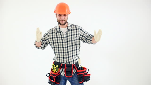 Handyman showing copy space and dancing