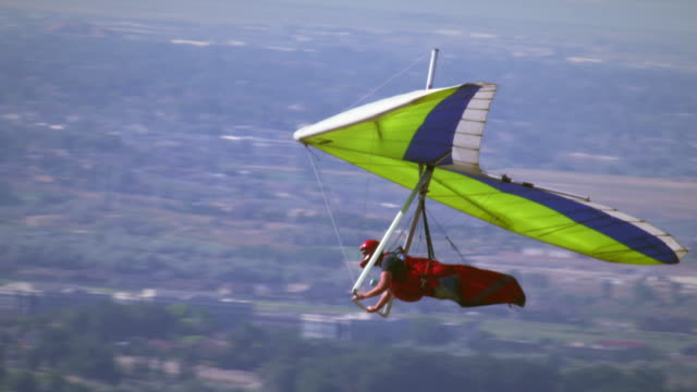 Hang glider is soaring over the South Salt Lake valley in UT.