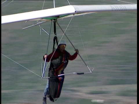 a hang glider lands. - hang gliding stock videos & royalty-free footage