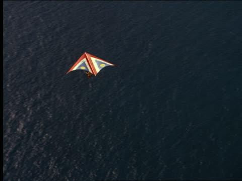 AERIAL hang glider over mountainous coastline