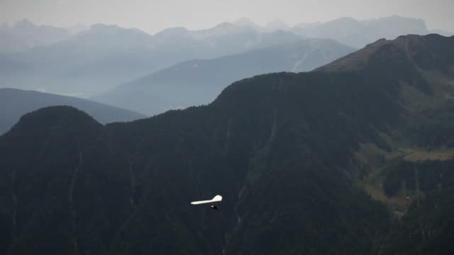 hang glider over the alps - hang gliding stock videos and b-roll footage