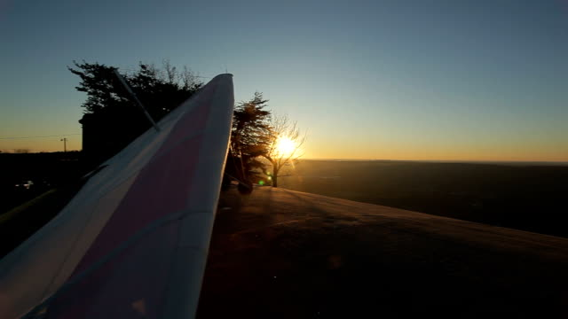 Hang Glider Ready to Take Off from Summit at Sunset