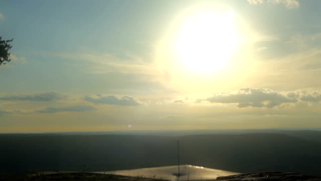 Hang Glider Taking Off from Summit at Sunset