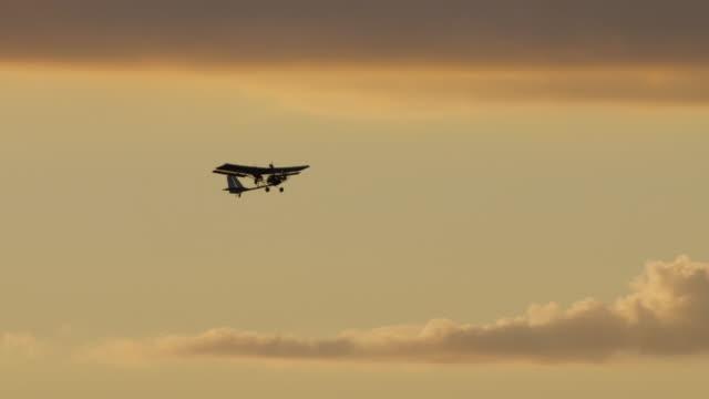 Hang gliding Flying at Sunset