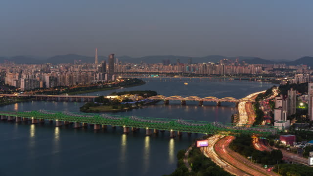 hangangcheolgyo railway bridge and hangangdaegyo bridge over han river, nodeulseom island and olympic expressway after sunset / dongjak-gu, seoul, south korea - railway bridge stock videos & royalty-free footage