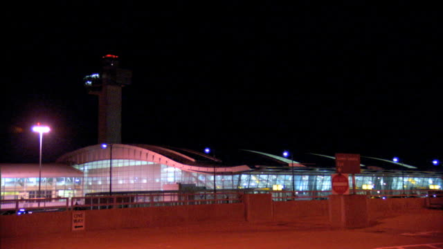 hanger and control tower at jfk international airport. nyc - kennedy airport stock videos & royalty-free footage