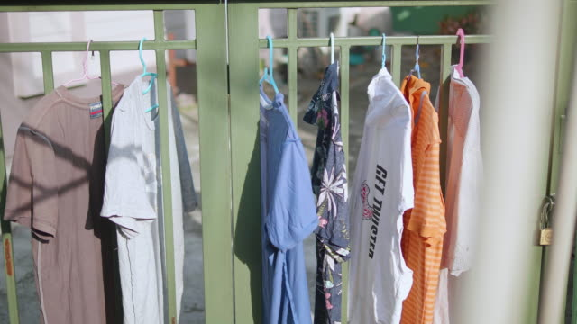 hanging clothes - clothesline stock videos & royalty-free footage