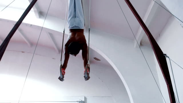 Hanging from gymnastics rings