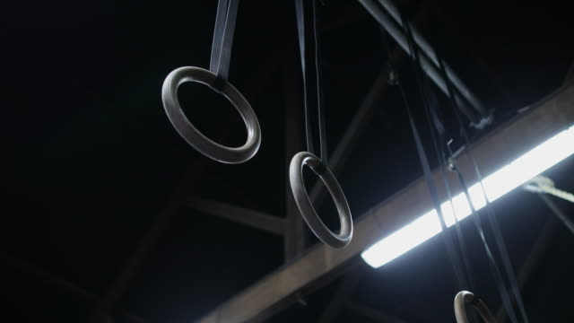 hanging gymnastic rings - gymnastics stock videos & royalty-free footage