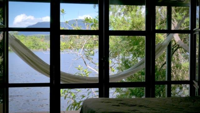 vídeos de stock e filmes b-roll de hanging hammock in the canaima national park carrao river - cama de rede