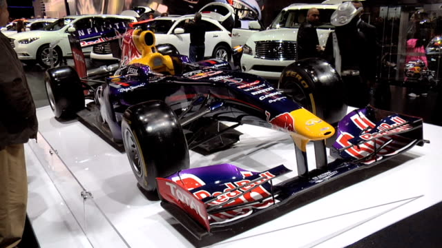 WS hanging Infiniti sign TILT DOWN to WS right side of RB9 race car / WS front quarter right side view / WS left side profile / ZOWS Formula One...