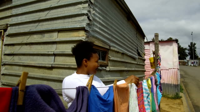 hanging laundry in the townships - slum stock videos & royalty-free footage