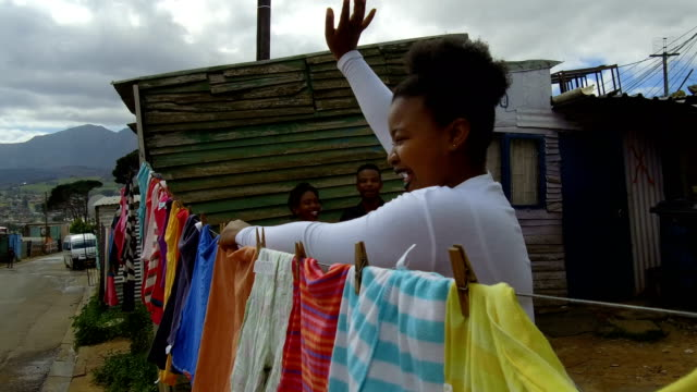 hanging laundry in the townships - township stock videos & royalty-free footage