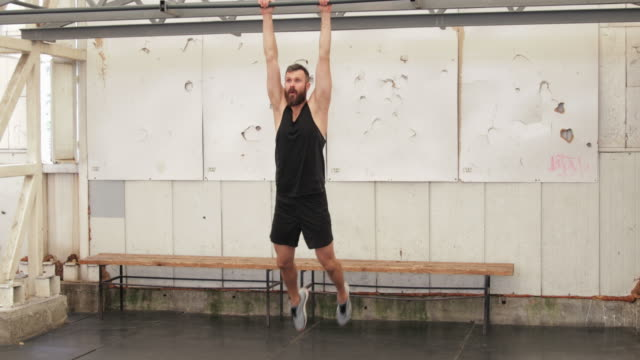 hanging leg raises, panning shot - hanging stock videos & royalty-free footage