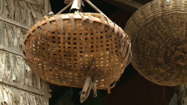 hanging native woven tray baskets by the window - wicker stock videos & royalty-free footage