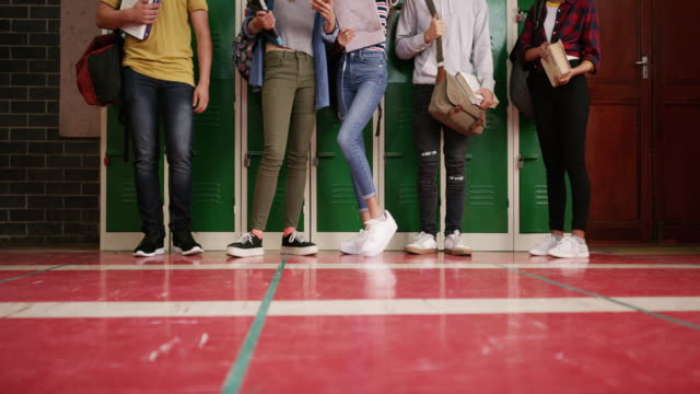 hanging out in the hallways of high school - locker stock videos & royalty-free footage