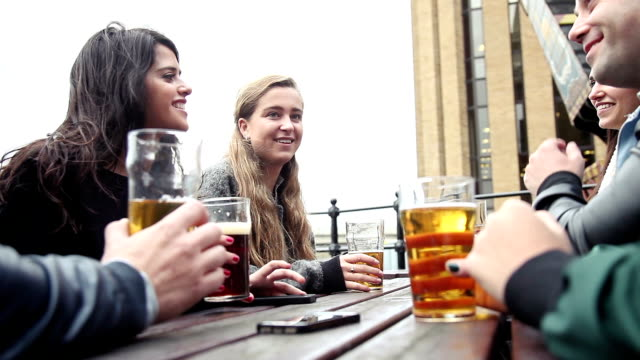 hanging out with a fresh beer in a london pub - pub stock videos & royalty-free footage