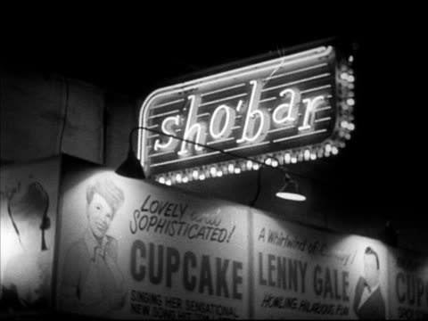 hanging 'sho' bar' neon sign w/ large advertising for 'cupcake' 'lenny gale' wall bg vs neon signs 'moulin rouge' 'famous door' burlesque theatre... - burlesque stock videos & royalty-free footage