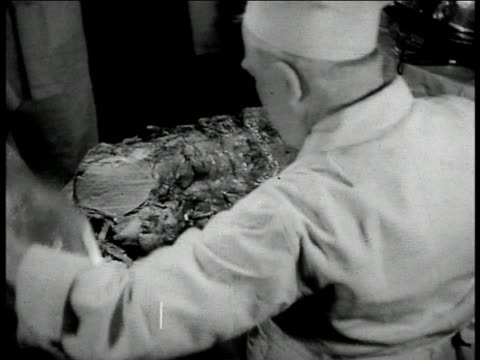 hanging side of beef roasting hand w/ ladle pouring juice over cooking meat ots man in chef's hat carving roast possibly mutton cu hands placing tray... - ladle stock videos & royalty-free footage
