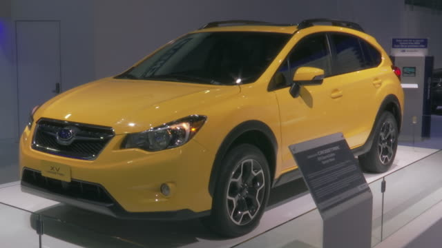 hanging subaru sign; tilt down - front quarter driver side view / front license plate; front end / rear license plate; rear quarter driver side view... - subaru stock videos & royalty-free footage