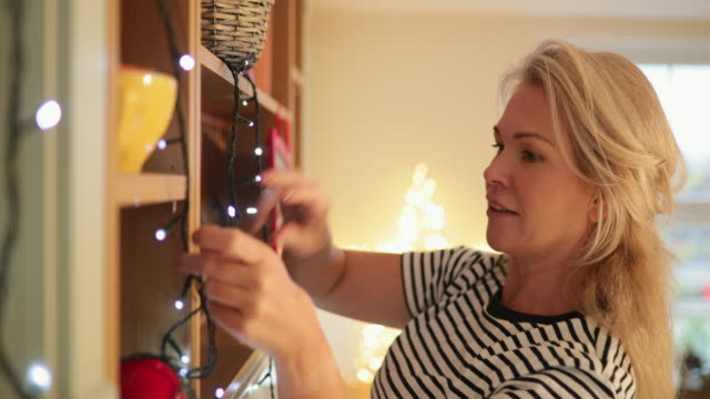 hanging up fairy lights - christmas decoration stock videos & royalty-free footage