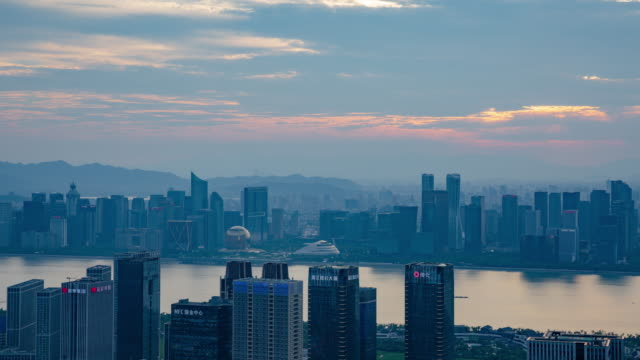 hangzhou skyline at sunset - 4k day to night timelapse - hangzhou stock videos & royalty-free footage