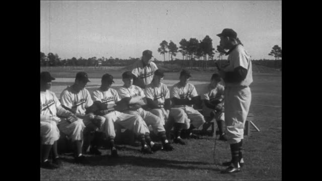 hank greenberg gives speech to rookies while holding a microphone, introduces tris speaker, who talks about fielding balls in the outfield. - baseball strip stock videos & royalty-free footage