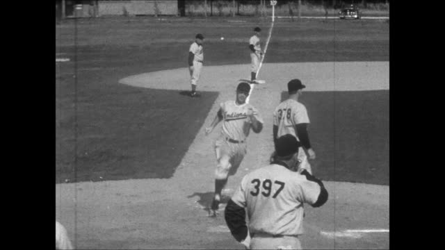 hank greenberg speaking into microphone narrates hitting and fielding drill while rookies listen / play is illustrated with hand moving miniatures... - spring training stock videos & royalty-free footage