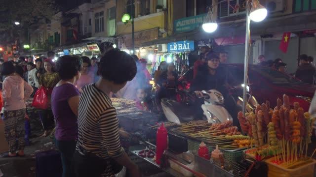 hanoi night market street barbecue food. hoan kiem old quarter town district - vietnam stock videos & royalty-free footage